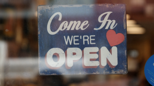 come in we are open for business sign